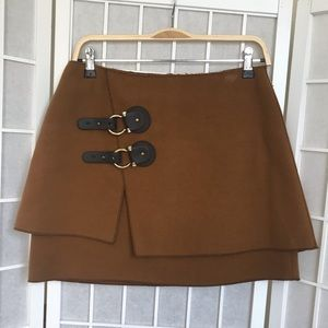 Gorgeous mini skirt with leather buckle detailing